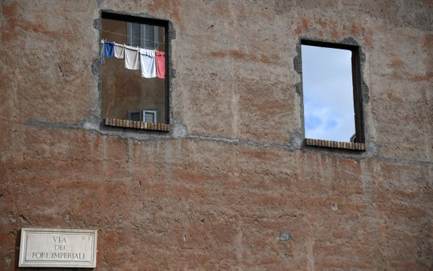A picture shows laundry drying through a window on the Imperial Forums avenue on March 6, 2017 in central...