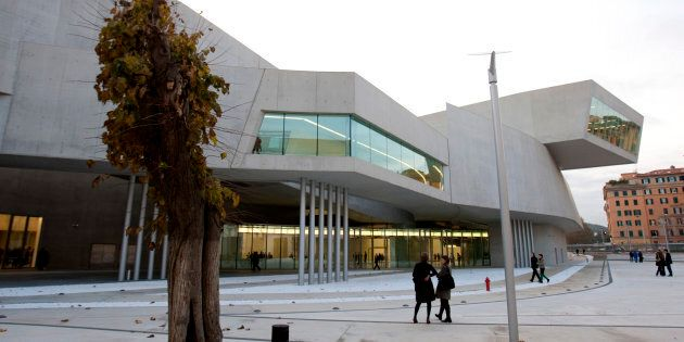 Guests walk outside Maxxi museum of contemporary art and architecture in Rome November 13, 2009. The...