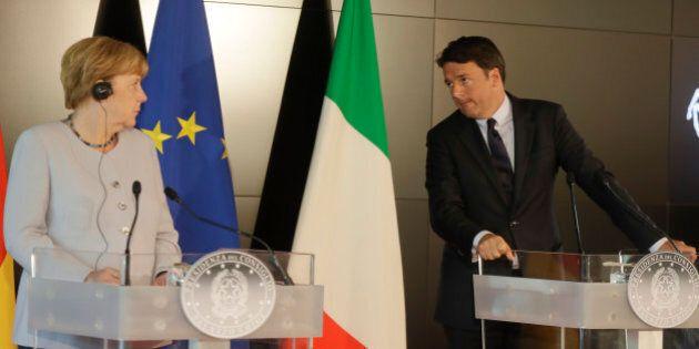 Italian Premier Matteo Renzi, right, and German Chancellor Angela Merkel meet the media during a news...