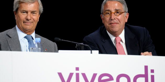 Chairman of the Supervisory Board of French media group Vivendi Vincent Bollore (L) and Vivendi CEO Arnaud...