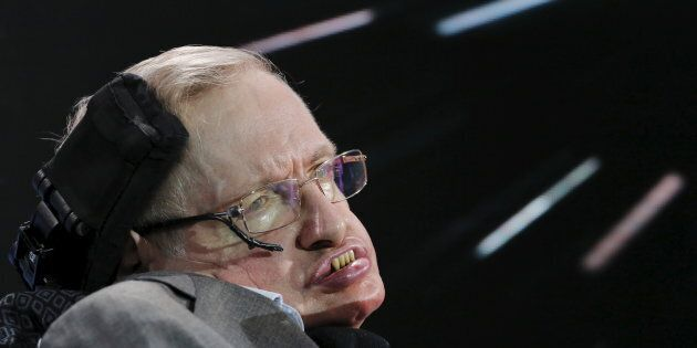 Physicist Stephen Hawking sits on stage during an announcement of the Breakthrough Starshot initiative...
