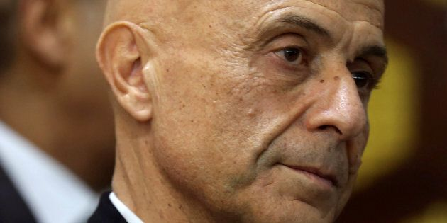 Italian Interior Minister Marco Minniti looks during a news conference with his Tunisian counterpart...