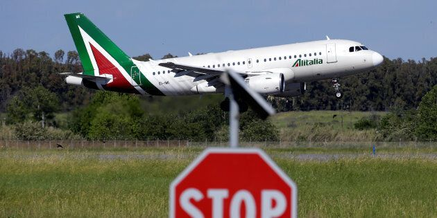An airplane of Alitalia approaches to land at Fiumicino international airport in Rome, central Italy,...