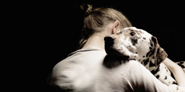 girl embracing her dog, studio