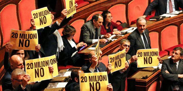 5-Star Movement senators protest holding placards