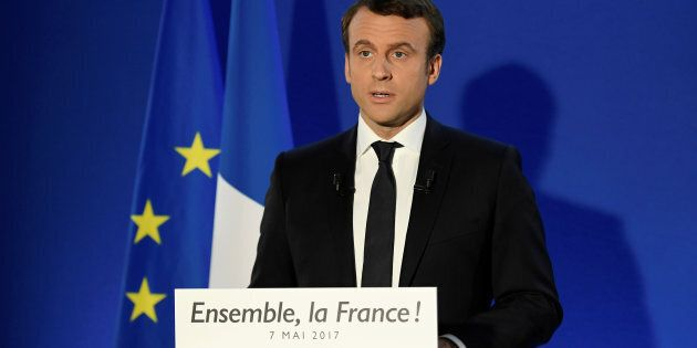 French President-elect Emmanuel Macron delivers a speech at his campaign headquarters after early results...