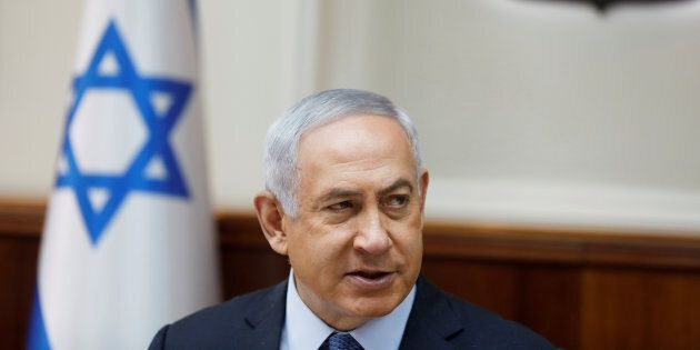 Israeli Prime Minister Benjamin Netanyahu attends the weekly cabinet meeting in Jerusalem September 10,...