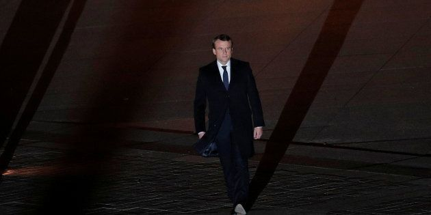French President elect Emmanuel Macron walks towards the stage at the Louvre Museum to give a speech...