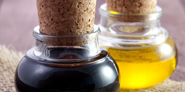 balsamic and oil in bottles on
