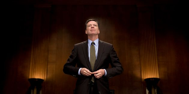 FBI Director James Comey prepares to testify before the Senate Judiciary Committee on Capitol Hill in...