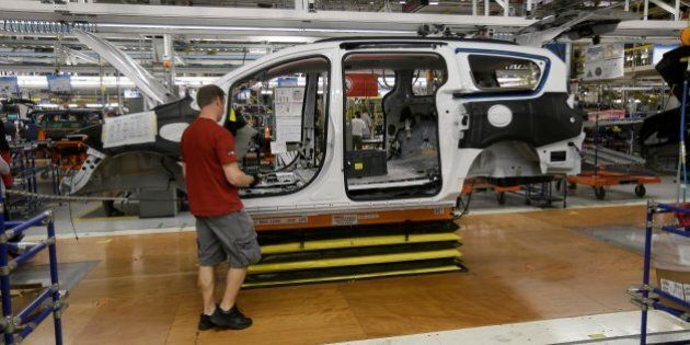Steve Vince works on a 2017 Chrysler Pacifica on the assembly line at the Windsor Assembly Plant, Friday,...