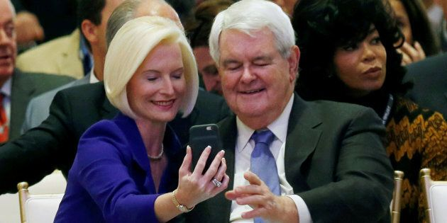 Callista (L) and Newt Gingrich take a selfie at an official ribbon cutting ceremony and opening news...