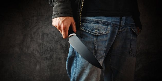 Evil man with shiny knife - a killer person with sharp knife about to commit a homicide, murder
