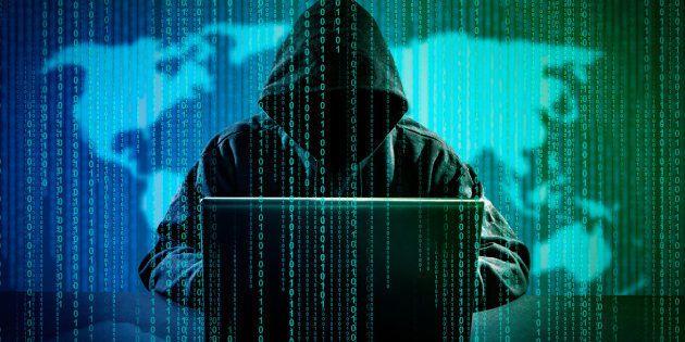 Hacker using laptop. Hacking the