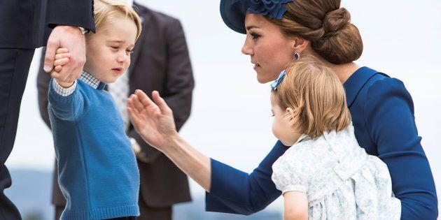 Britain's Prince William, Catherine, Duchess of Cambridge, Prince George and Princess Charlotte arrive...
