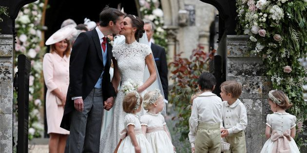 Pippa Middleton and James Matthews kiss after their wedding at St Mark's Church in Englefield, Britain...