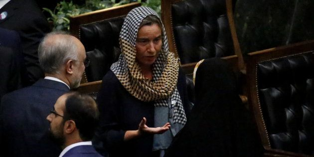 EU foreign policy chief Federica Mogherini speaks to officals after Iran's President's swearing in ceremony...