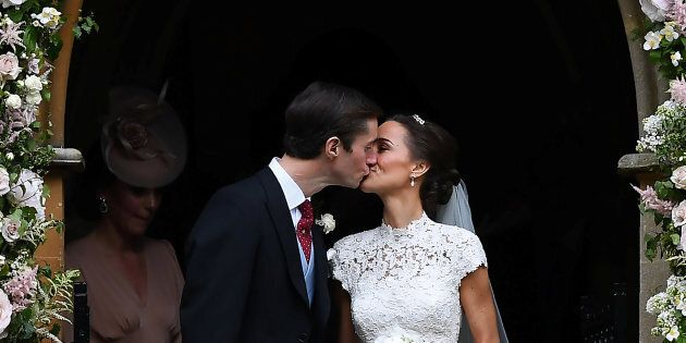 Pippa Middleton kisses her new husband James Matthews, following their wedding ceremony at St Mark's...