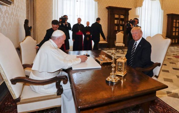 Pope Francis (L) meets with US President Donald Trump during a private audience at the Vatican on May...