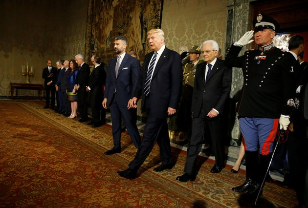 U.S. President Donald Trump walks beside Italy's President Sergio Mattarella (2ndR) at the Quirinale...