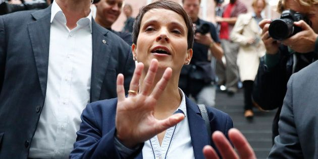Frauke Petry, chairwoman of the anti-immigration party Alternative fuer Deutschland (AfD) reacts as she...