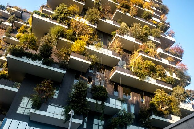 MILANO, ITALY - 2016/11/14: The Bosco Verticale buildings in autumn in Porta Nuova complex. The complex...