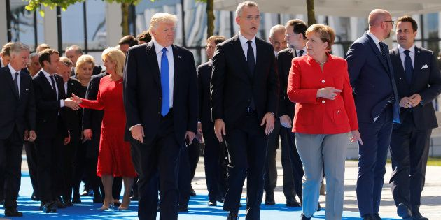(L-R) U.S. President Donald Trump, NATO Secretary General Jens Stoltenberg and German Chancellor Angela...