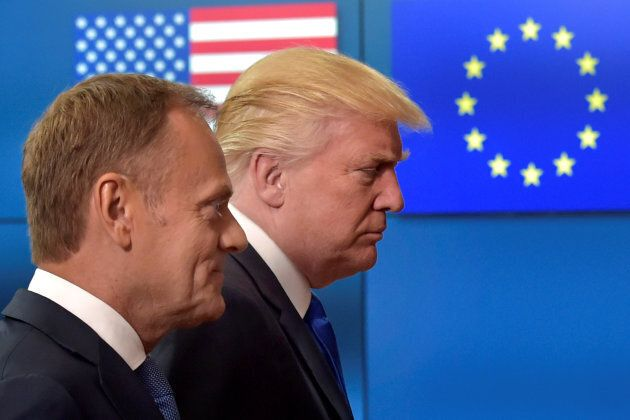 U.S. President Donald Trump (R) walks with the President of the European Council Donald Tusk in Brussels,...