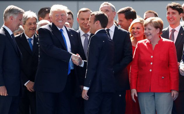 From L-R, Belgium's King Philipe, Italian Prime Minister Paolo Gentiloni, U.S. President Donald Trump...