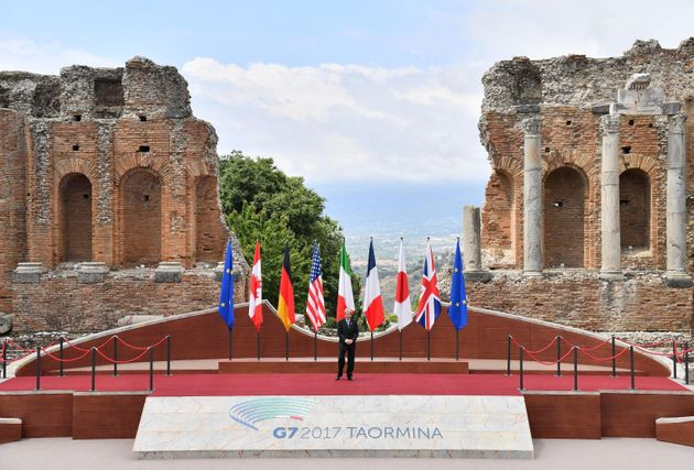 Italian Premier Paolo Gentiloni arrives for a welcome ceremony for the G7 summit in the Ancient Theatre...