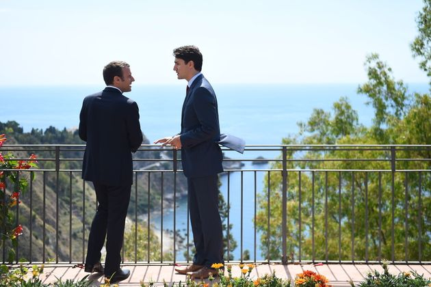Canadian Prime Minister Justin Trudeau and French President Emmanuel Macron talk as they attend the Summit...