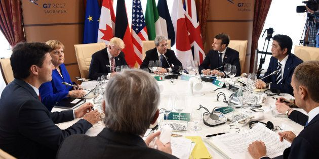 G7 Summit members attend the first working session, with from bottom C, President of the European Commission...