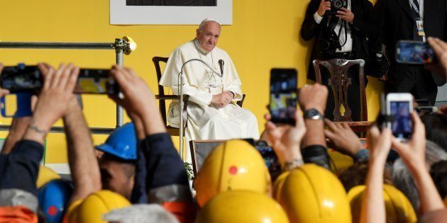 Pope Francis attends a meeting with workers of the Ilva steel plant as part of a one-day visit in Genoa,...