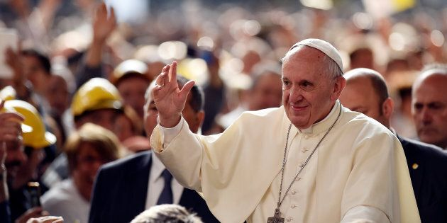 Pope Francis waves as he arrives at the ILVA steel plant during his pastoral visit in Genoa, Italy, May...