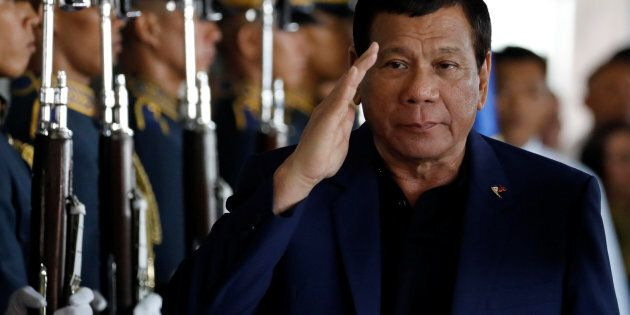 Philippine President Rodrigo Duterte salutes the honor guards upon arrival from Russia at the Ninoy Aquino...