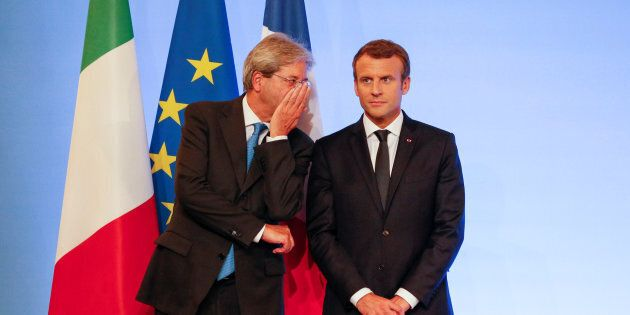 French President Emmanuel Macron and Italian Prime Minister Paolo Gentiloni attend a signing ceremony...