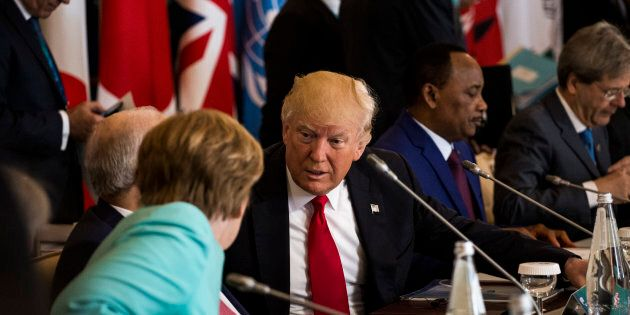 German Chancellor Angela Merkel (L) talks to U.S. President Donald Trump during the G7 Summit expanded...