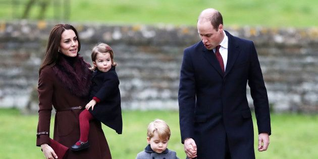 Prince William, the Duke of Cambridge (R), his wife Catherine, The Duchess of Cambridge (L), Prince George...