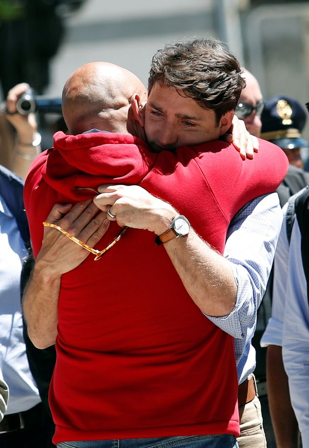 Canada's Prime Minster Justin Trudeau embraces Amatrice mayor Sergio Pirozzi during his visit to the...