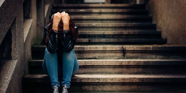 Depressed teenager sitting
