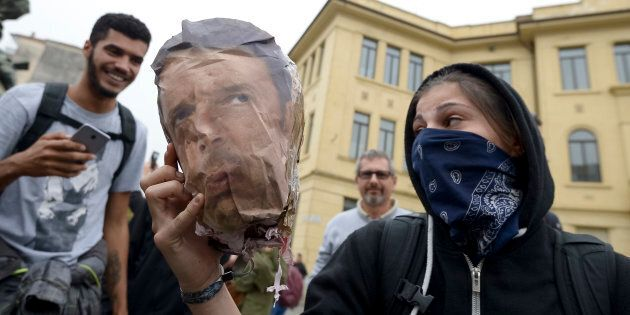 VENARIA, TURIN, ITALY - 2017/09/30: A demonstrator shows the head of a dummy with the face of Matteo...