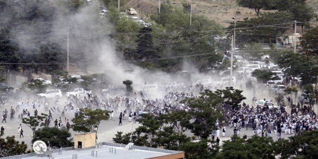 epa06007718 People run after an explosion during the funeral of one of the victims of 02 June violent...