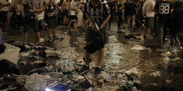 Juventus' supporters look for personal belongings in Piazza San Carlo after a panic movement in the fanzone...