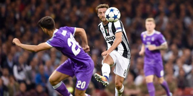 Claudio Marchisio of Juventus is challenged by Isco of Real Madrid during the UEFA Champions League Final...