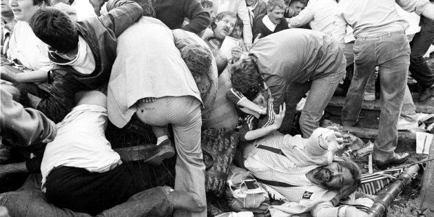FILE PHOTO 29MAY85 - Juventus soccer fans struggle to get free from a crush after a wall collapsed during...