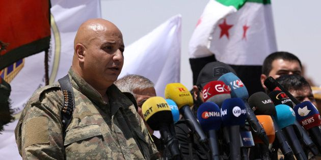 Syrian Democratic Forces (SDF) spokesman Talal Silo speaks during a press conference in Hukoumiya village...