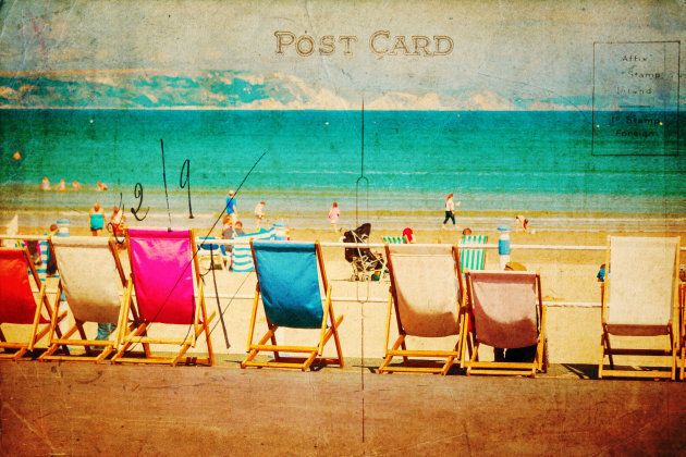 vintage style postcard with a beach scene, deckchairs standing in a row at the seaside promenade of Weymouth,