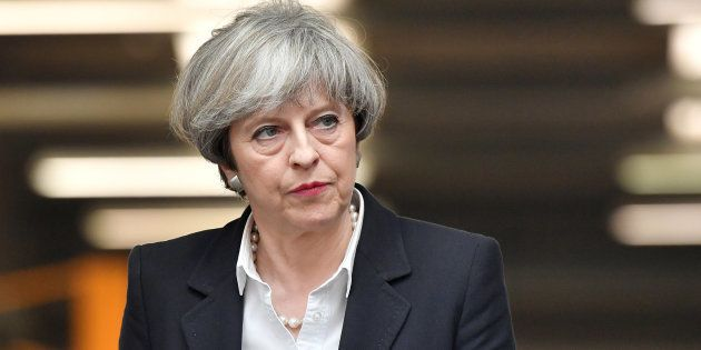 Britain's Prime Minister Theresa May looks on during a general election campaign visit to a tool factory...