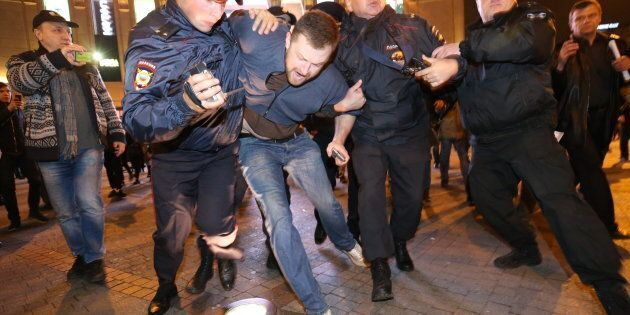 ST PETERSBURG, RUSSIA - OCTOBER 7, 2017: Policemen detain participants in an unauthorized rally in support...
