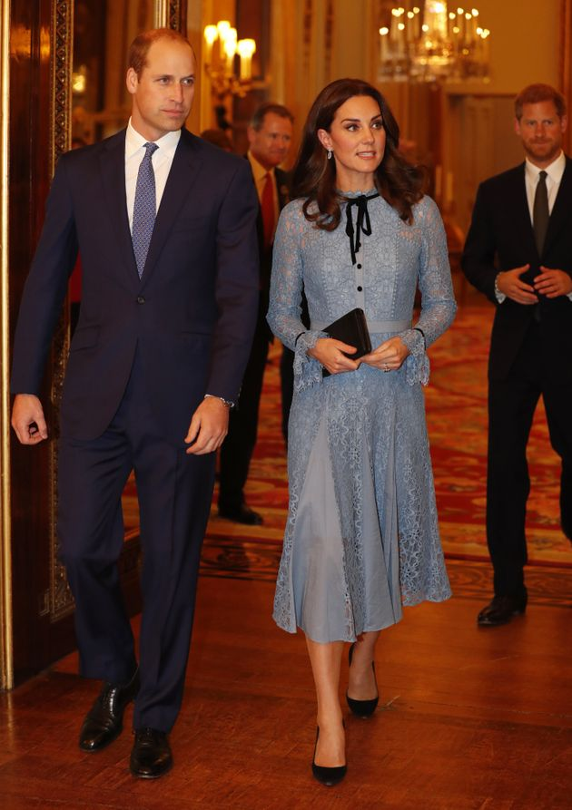 Britain's Prince William, Kate, the Duchess of Cambridge and Prince Harry attend a reception at Buckingham...
